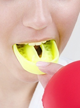 Woman with mouth guard
