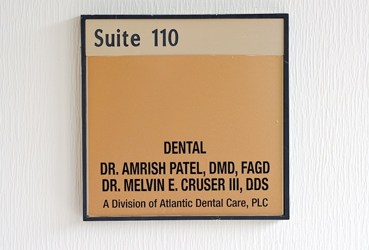 Dr. Amish and Dr. Patel sign