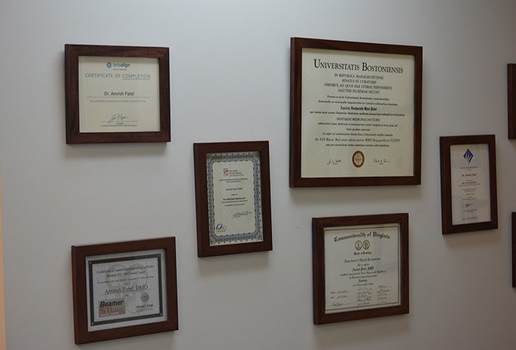 Diplomas and certificates on wall